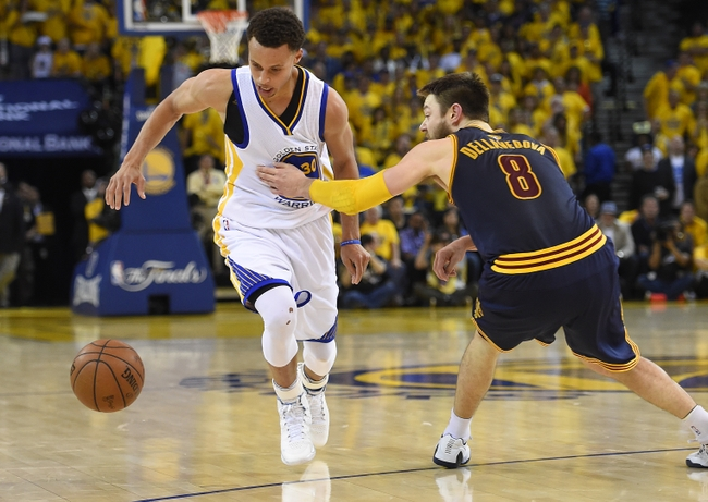 Jun 14, 2015; Oakland, CA, USA; Golden State Warriors guard Stephen Curry (30) drives to the basket against Cleveland Cavaliers guard Matthew Dellavedova (8) during the fourth quarter in game five of the NBA Finals at Oracle Arena. Mandatory Credit: Bob Donnan-USA TODAY Sports