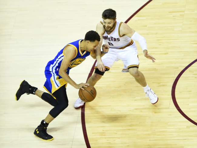 Jun 16, 2015; Cleveland, OH, USA; Golden State Warriors guard Stephen Curry (30) drives against Cleveland Cavaliers guard Matthew Dellavedova (8) during the first quarter of game six of the NBA Finals at Quicken Loans Arena. Mandatory Credit: Ken Blaze-USA TODAY Sports