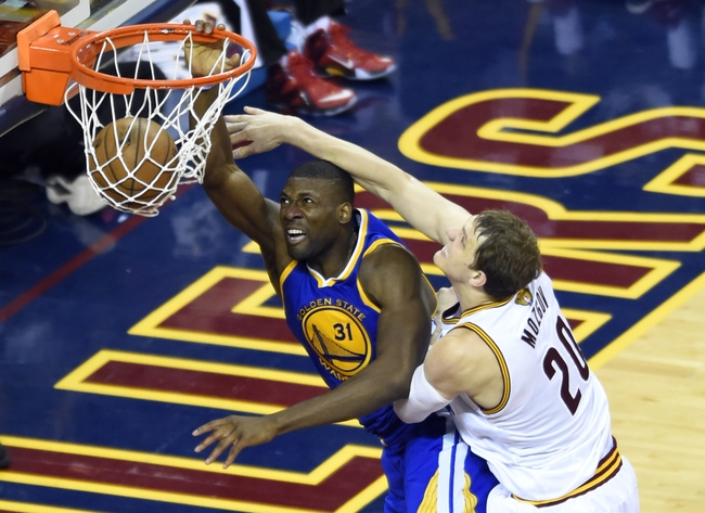 Jun 16, 2015; Cleveland, OH, USA; Golden State Warriors center Festus Ezeli (31) dunks against Cleveland Cavaliers center Timofey Mozgov (20) during the fourth quarter of game six of the NBA Finals at Quicken Loans Arena. Mandatory Credit: Ken Blaze-USA TODAY Sports