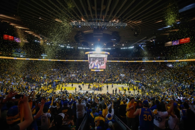Jun 16, 2015; Oakland, CA, USA; Golden State Warriors fans celebrate during a watch party as Warriors win game 6 of the NBA Finals against Cleveland Cavaliers at Oracle Arena. Mandatory Credit: Kelley L Cox-USA TODAY Sports
