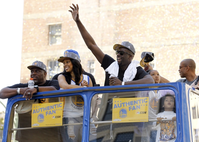 Jun 19, 2015; Oakland, CA, USA; Golden State Warriors forward Draymond Green waves to the crowd during the Golden State Warriors 2015 championship celebration in downtown Oakland. Mandatory Credit: Cary Edmondson-USA TODAY Sports