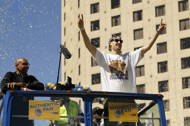 Jun 19, 2015; Oakland, CA, USA; Golden State Warriors guard Klay Thompson raises his arms during the Golden State Warriors 2015 championship celebration in downtown Oakland. Mandatory Credit: Cary Edmondson-USA TODAY Sports