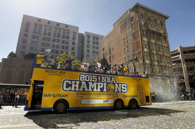 Jun 19, 2015; Oakland, CA, USA; A double-decker bus travels down the street during the Golden State Warriors 2015 championship celebration in downtown Oakland. Mandatory Credit: Cary Edmondson-USA TODAY Sports
