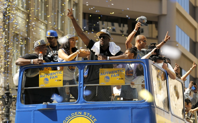 Jun 19, 2015; Oakland, CA, USA; Golden State Warriors forward Draymond Green acknowledges the crowd during the Golden State Warriors 2015 championship celebration in downtown Oakland. Mandatory Credit: Cary Edmondson-USA TODAY Sports