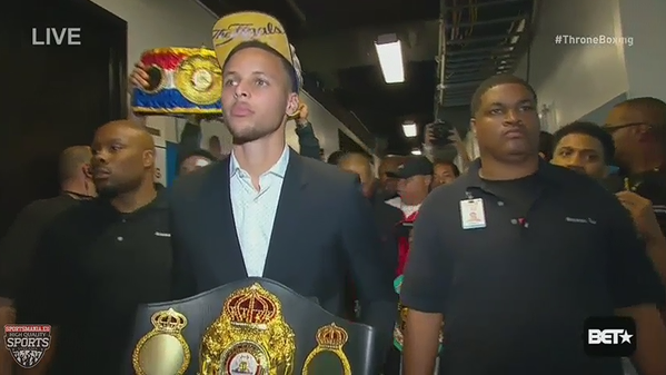 Curry holding the belt