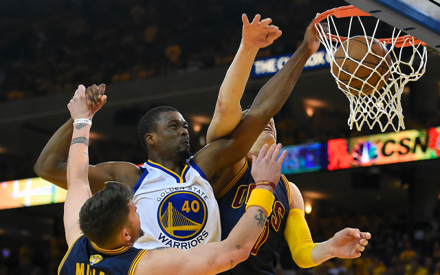 Jun 14, 2015; Oakland, CA, USA; Golden State Warriors forward Harrison Barnes (40) dunks the ball over Cleveland Cavaliers guard Mike Miller (18) and center Timofey Mozgov (20) during the fourth quarter in game five of the NBA Finals at Oracle Arena. Mandatory Credit: Bob Donnan-USA TODAY Sports