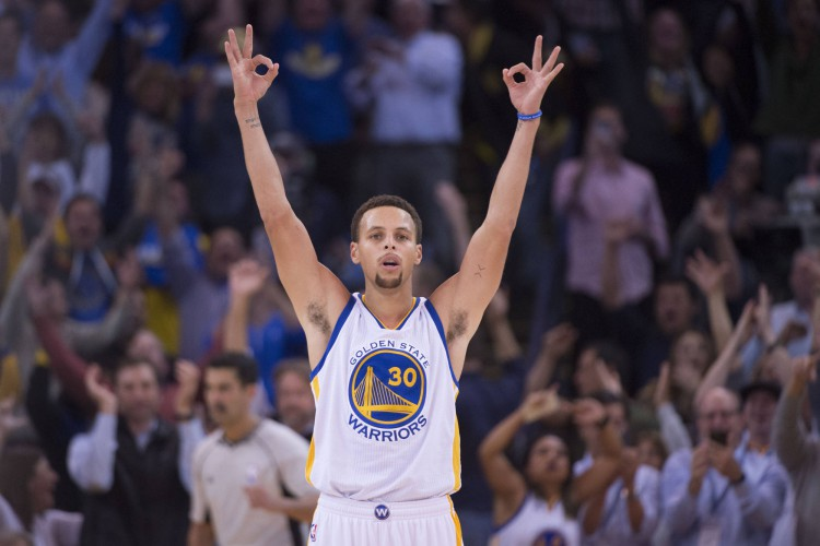 November 4, 2015; Oakland, CA, USA; Golden State Warriors guard Stephen Curry (30) celebrates after making a three-point shot during the fourth quarter against the Los Angeles Clippers at Oracle Arena. The Warriors defeated the Clippers 112-108. Mandatory Credit: Kyle Terada-USA TODAY Sports