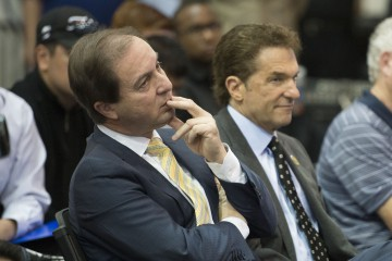 May 20, 2014; Oakland, CA, USA; Golden State Warriors co-owners Joe Lacob (left) and Peter Guber (right) watch as Steve Kerr (not pictured) addresses the media in a press conference after being introduced as the new head coach for the Warriors at the Warriors Practice Facility. Mandatory Credit: Kyle Terada-USA TODAY Sports