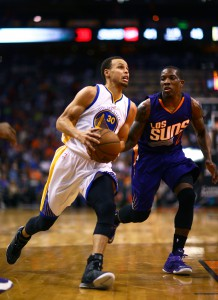 Mar 9, 2015; Phoenix, AZ, USA; Golden State Warriors guard Stephen Curry (30) drives to the basket against Phoenix Suns guard Eric Bledsoe (2) at US Airways Center. The Warriors defeated the Suns 98-80. Mandatory Credit: Mark J. Rebilas-USA TODAY Sports