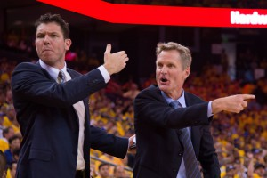 Luke Walton (left) and head coach Steve Kerr (right) react during the second quarter in game one of the first round of the NBA Playoffs against the New Orleans Pelicans at Oracle Arena. The Warriors defeated the Pelicans 106-99. Mandatory Credit: Kyle Terada-USA TODAY Sports
