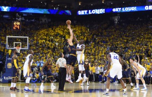 Jun 14, 2015; Oakland, CA, USA; Cleveland Cavaliers center Timofey Mozgov (20) and Golden State Warriors forward Draymond Green (23) go for the opening tip in game five of the NBA Finals at Oracle Arena. Mandatory Credit: Bob Donnan-USA TODAY Sports