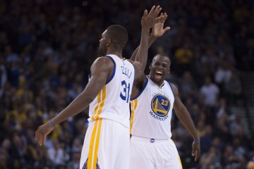 November 2, 2015; Oakland, CA, USA; Golden State Warriors forward Draymond Green (23) celebrates with center Festus Ezeli (31) against the Memphis Grizzlies during the first quarter at Oracle Arena. The Warriors defeated the Grizzlies 119-69. Mandatory Credit: Kyle Terada-USA TODAY Sports