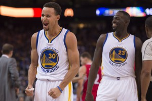 November 4, 2015; Oakland, CA, USA; Golden State Warriors guard Stephen Curry (30) and forward Draymond Green (23) celebrate during the fourth quarter against the Los Angeles Clippers at Oracle Arena. The Warriors defeated the Clippers 112-108. Mandatory Credit: Kyle Terada-USA TODAY Sports