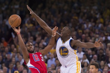 November 4, 2015; Oakland, CA, USA; Los Angeles Clippers guard Chris Paul (3) shoots the basketball against Golden State Warriors forward Draymond Green (23) during the fourth quarter at Oracle Arena. The Warriors defeated the Clippers 112-108. Mandatory Credit: Kyle Terada-USA TODAY Sports