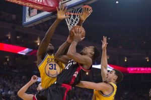 November 17, 2015; Oakland, CA, USA; Toronto Raptors guard DeMar DeRozan (10) shoots the basketball against Golden State Warriors center Festus Ezeli (31) and guard Klay Thompson (11) during the first quarter at Oracle Arena. Mandatory Credit: Kyle Terada-USA TODAY Sports
