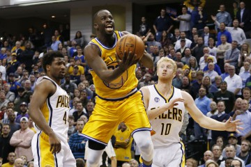 Dec 8, 2015; Indianapolis, IN, USA; Golden State Warriors forward Draymond Green (23) takes a shot against Indiana Pacers forward Solomon Hill (44) at Bankers Life Fieldhouse. Golden State defeats Indiana 131-123. Mandatory Credit: Brian Spurlock-USA TODAY Sports