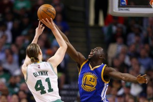 Dec 11, 2015; Boston, MA, USA; Golden State Warriors forward Draymond Green (23) goes up to block a shot by Boston Celtics center Kelly Olynyk (41) during the first half at TD Garden. Mandatory Credit: Winslow Townson-USA TODAY Sports
