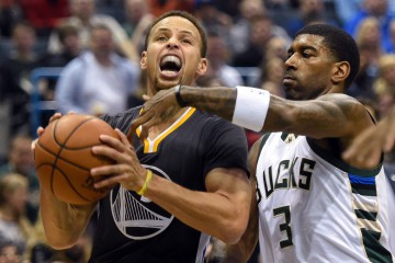 Dec 12, 2015; Milwaukee, WI, USA;  Golden State Warriors guard Stephen Curry (30) drives for the basket against Milwaukee Bucks guard O.J. Mayo (3) in the first quarter at BMO Harris Bradley Center. Mandatory Credit: Benny Sieu-USA TODAY Sports