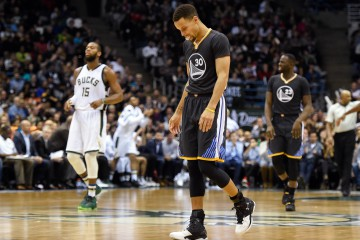 Dec 12, 2015; Milwaukee, WI, USA;  Golden State Warriors guard Stephen Curry (30) reacts in the fourth quarter during the game against the Milwaukee Bucks at BMO Harris Bradley Center. The Bucks beat the Warriors 108-95. Mandatory Credit: Benny Sieu-USA TODAY Sports