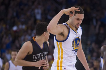 December 16, 2015; Oakland, CA, USA; Golden State Warriors guard Klay Thompson (11) celebrates a three-point basket during the third quarter against the Phoenix Suns at Oracle Arena. The Warriors defeated the Sun 128-103. Mandatory Credit: Kyle Terada-USA TODAY Sports