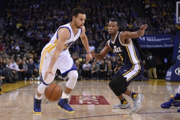 December 23, 2015; Oakland, CA, USA; Golden State Warriors guard Stephen Curry (30) dribbles against Utah Jazz guard Rodney Hood (5) during the first quarter at Oracle Arena. Mandatory Credit: Kyle Terada-USA TODAY Sports