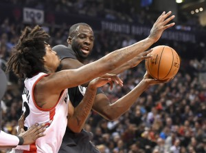 Dec 5, 2015; Toronto, Ontario, CAN; Golden State Warriors forward Draymond Green (23) is blocked going to the net by Toronto Raptors center Lucas Nogueira (92) during the first quarter at Air Canada Centre. Mandatory Credit: Dan Hamilton-USA TODAY Sports