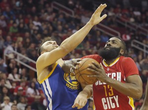 Dec 31, 2015; Houston, TX, USA; Houston Rockets guard James Harden (13) is called for charging against Golden State Warriors center Andrew Bogut (12) in the first quarter at Toyota Center. Mandatory Credit: Thomas B. Shea-USA TODAY Sports