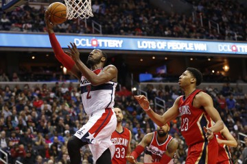 Nov 29, 2014; Washington, DC, USA; Washington Wizards guard John Wall (2) shoots the ball ahead of New Orleans Pelicans forward Anthony Davis (23) in the third quarter at Verizon Center. The Wizards won 83-80. Mandatory Credit: Geoff Burke-USA TODAY Sports