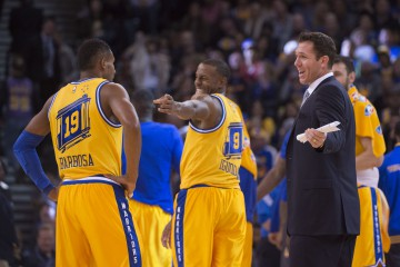 November 24, 2015; Oakland, CA, USA; Golden State Warriors interim head coach Luke Walton (right) talks to guard Leandro Barbosa (19) and guard Andre Iguodala (9) during the third quarter against the Los Angeles Lakers at Oracle Arena. The Warriors defeated the Lakers 111-77. Mandatory Credit: Kyle Terada-USA TODAY Sports