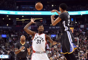 Dec 5, 2015; Toronto, Ontario, CAN; Golden State Warriors guard Shaun Livingston (34) throws a pass to forward Marreese Speights (5) over Toronto Raptors guard Terrence Ross (31) in the second quarter at Air Canada Centre. Mandatory Credit: Dan Hamilton-USA TODAY Sports