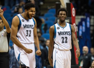 Dec 7, 2015; Minneapolis, MN, USA; Minnesota Timberwolves guard Andrew Wiggins (22) celebrates with center Karl-Anthony Towns (32) against the Los Angeles Clippers at Target Center. The Clippers defeated the Timberwolves 110-106. Mandatory Credit: Brace Hemmelgarn-USA TODAY Sports