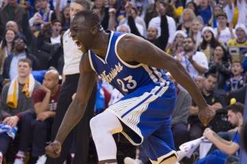 December 25, 2015; Oakland, CA, USA; Golden State Warriors forward Draymond Green (23) celebrates in the fourth quarter of a NBA basketball game on Christmas against the Cleveland Cavaliers at Oracle Arena. The Warriors defeated the Cavaliers 89-83.  Mandatory Credit: Kyle Terada-USA TODAY Sports