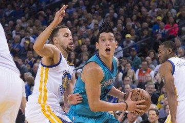 January 4, 2016; Oakland, CA, USA; Charlotte Hornets guard Jeremy Lin (7, right) dribbles the basketball against Golden State Warriors guard Stephen Curry (30, left) during the third quarter at Oracle Arena. The Warriors defeated the Hornets 111-101. Mandatory Credit: Kyle Terada-USA TODAY Sports