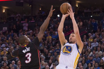 January 11, 2016; Oakland, CA, USA; Golden State Warriors guard Klay Thompson (11) shoots the basketball against Miami Heat guard Dwyane Wade (3) during the fourth quarter at Oracle Arena. The Warriors defeated the Heat 111-103. Mandatory Credit: Kyle Terada-USA TODAY Sports