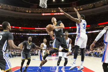 Jan 30, 2016; Philadelphia, PA, USA; Golden State Warriors guard Stephen Curry (30) scores past Philadelphia 76ers guard Hollis Thompson (31) during the second half at Wells Fargo Center. 108-105. Mandatory Credit: Bill Streicher-USA TODAY Sports