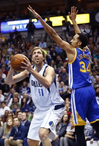 Dec 30, 2015; Dallas, TX, USA; Dallas Mavericks forward Dirk Nowitzki (41) shoots as Golden State Warriors guard Shaun Livingston (34) defends during the first quarter at American Airlines Center. Mandatory Credit: Kevin Jairaj-USA TODAY Sports