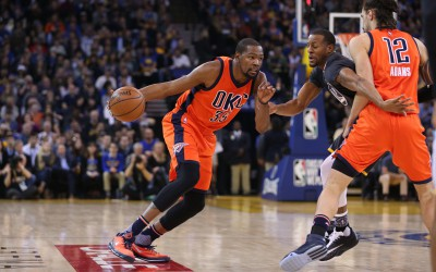 Feb 6, 2016; Oakland, CA, USA; Oklahoma City Thunder forward Kevin Durant (35) dribbles the ball past Golden State Warriors forward Andre Iguodala (9) in the first quarter at Oracle Arena. Mandatory Credit: Cary Edmondson-USA TODAY Sports