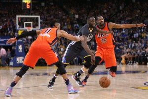 Feb 6, 2016; Oakland, CA, USA; Golden State Warriors forward Draymond Green (23) dribbles the ball between Oklahoma City Thunder guard Russell Westbrook (0) and forward Kevin Durant (35) in the third quarter at Oracle Arena. The Warriors won 116-108. Mandatory Credit: Cary Edmondson-USA TODAY Sports