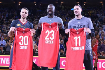February 9, 2016; Oakland, CA, USA; Golden State Warriors guard Stephen Curry (30), forward Draymond Green (23), and guard Klay Thompson (11) hold their all star jerseys before the game against the Houston Rockets at Oracle Arena. Mandatory Credit: Kyle Terada-USA TODAY Sports