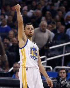 Feb 25, 2016; Orlando, FL, USA; Golden State Warriors guard Stephen Curry (30) celebrates a three point basket during the second half of a basketball game against the Orlando Magic at Amway Center. The Warriors won 130-114. Mandatory Credit: Reinhold Matay-USA TODAY Sports