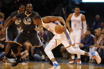 Feb 27, 2016; Oklahoma City, OK, USA; Oklahoma City Thunder forward Kevin Durant (35) drives to the basket in front of Golden State Warriors forward Draymond Green (23) during the second quarter at Chesapeake Energy Arena. Mandatory Credit: Mark D. Smith-USA TODAY Sports