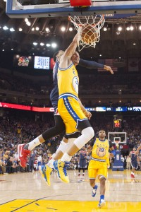 March 29, 2016; Oakland, CA, USA; Golden State Warriors guard Stephen Curry (30) dunks the basketball against Washington Wizards guard Garrett Temple (17) during the first quarter at Oracle Arena. Mandatory Credit: Kyle Terada-USA TODAY Sports