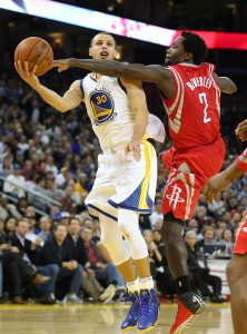 Feb 20, 2014; Oakland, CA, USA; Houston Rockets point guard Patrick Beverley (2) fouls Golden State Warriors point guard Stephen Curry (30) during the fourth quarter at Oracle Arena. The Golden State Warriors defeated the Houston Rockets 102-99 in overtime. Mandatory Credit: Kelley L Cox-USA TODAY Sports