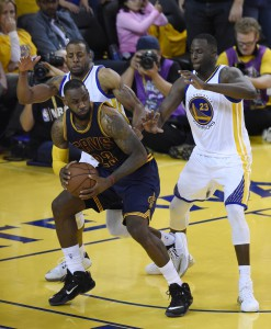 June 7, 2015; Oakland, CA, USA; Cleveland Cavaliers forward LeBron James (23) controls the ball against Golden State Warriors forward Draymond Green (23) and guard Andre Iguodala (9) during the overtime period in game two of the NBA Finals at Oracle Arena. Mandatory Credit: Bob Donnan-USA TODAY Sports
