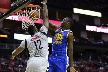 Oct 30, 2015; Houston, TX, USA; Golden State Warriors forward Harrison Barnes (40) dunks the ball over Houston Rockets center Dwight Howard (12) during the first quarter at Toyota Center. Mandatory Credit: Troy Taormina-USA TODAY Sports
