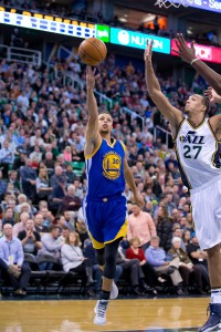 Nov 30, 2015; Salt Lake City, UT, USA; Golden State Warriors guard Stephen Curry (30) puts up a shot in front of Utah Jazz center Rudy Gobert (27) during the first quarter at Vivint Smart Home Arena. Mandatory Credit: Russ Isabella-USA TODAY Sports