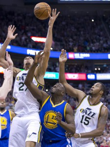 Nov 30, 2015; Salt Lake City, UT, USA; Utah Jazz center Rudy Gobert (27) and forward Derrick Favors (15) and Golden State Warriors forward Draymond Green (23) battle for a rebound during the second half at Vivint Smart Home Arena. The Warriors won 106-103. Mandatory Credit: Russ Isabella-USA TODAY Sports