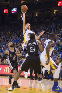 January 25, 2016; Oakland, CA, USA; Golden State Warriors guard Stephen Curry (30) shoots the basketball against San Antonio Spurs forward Kawhi Leonard (2) during the second quarter at Oracle Arena. Mandatory Credit: Kyle Terada-USA TODAY Sports