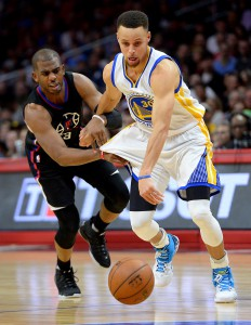 Feb 20, 2016; Los Angeles, CA, USA; Los Angeles Clippers guard Chris Paul (3) defends Golden State Warriors guard Stephen Curry (30) as he drives to the basket in the first half of the game at Staples Center. Mandatory Credit: Jayne Kamin-Oncea-USA TODAY Sports