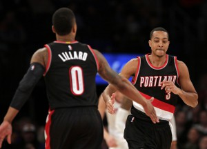 Mar 1, 2016; New York, NY, USA; Portland Trail Blazers guard C.J. McCollum (3) celebrates with guard Damian Lillard (0) against the New York Knicks during the second half at Madison Square Garden. The Trail Blazers defeated the Knicks 104-85. Mandatory Credit: Adam Hunger-USA TODAY Sports
